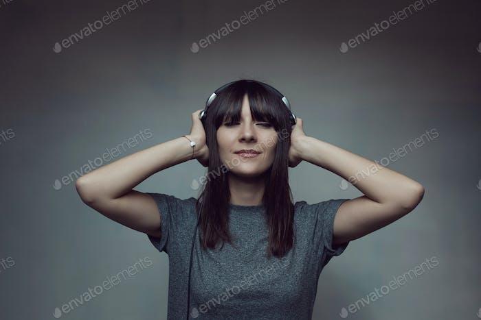 Pretty brunette woman posing in light room
