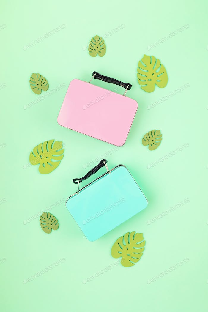 Travel baggage suitcase with summer vacations accessories. Summer holidays, travel to tropical