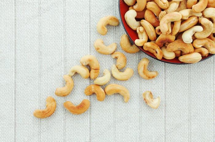 Cashew nuts roasted salt on tablecloth