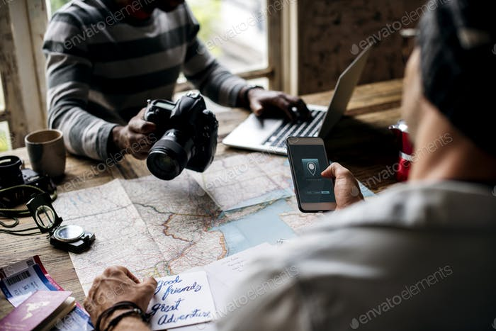 Men planning the journey with map and gps