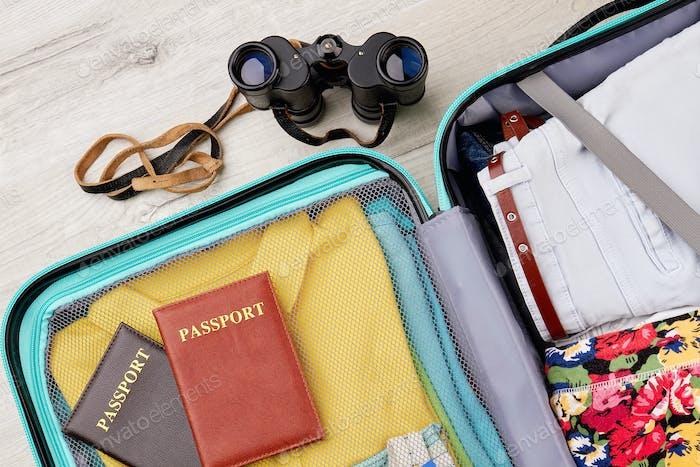 Full suitcase, passports, binocular