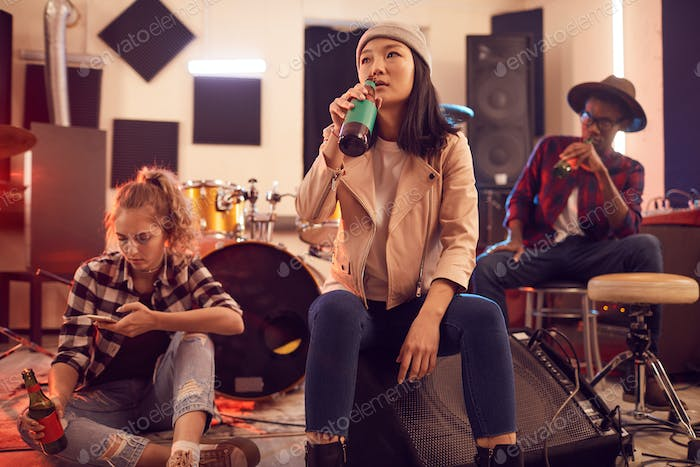 Contemporary Young People in Music Studio