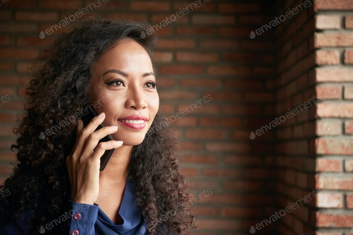 Attractive Asian Woman Using Smartphone