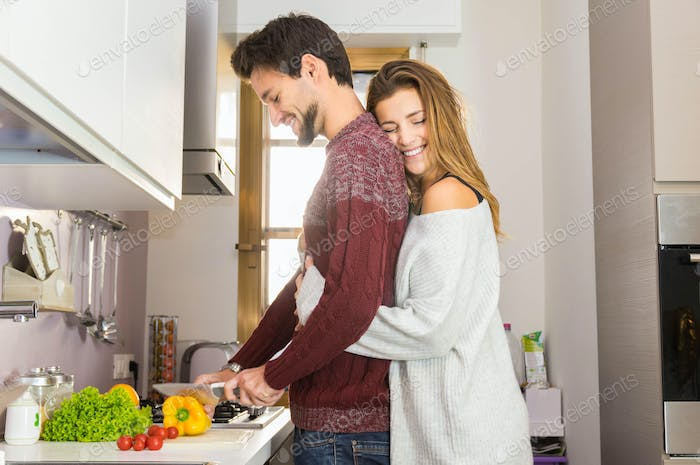 Romantic couple in love cooking vegetables healthy food together at home