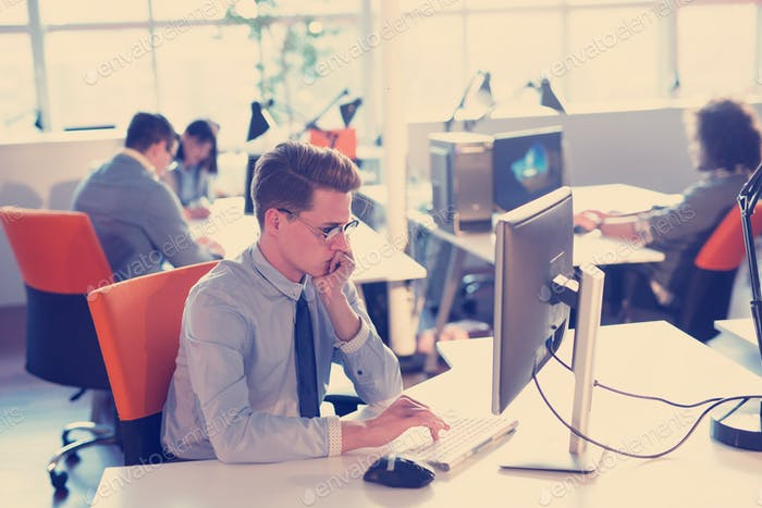 businessman working using a computer in startup office