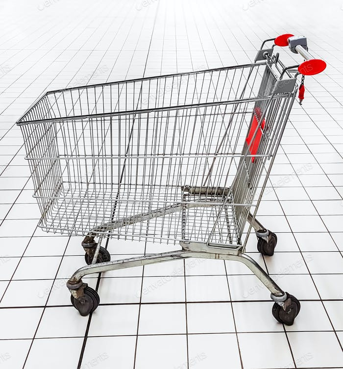 empty shopping trolley in a supermarket.