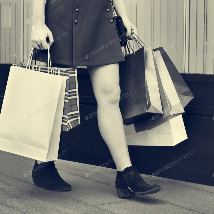 Young Woman Shopping Consumer Concept