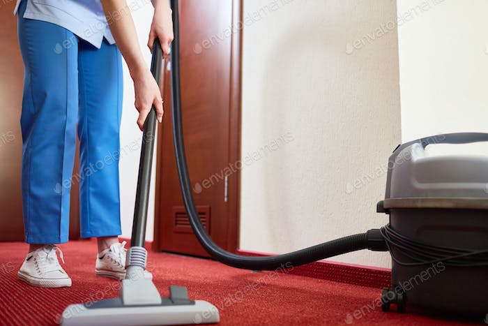 Cleaning carpet in hotel room