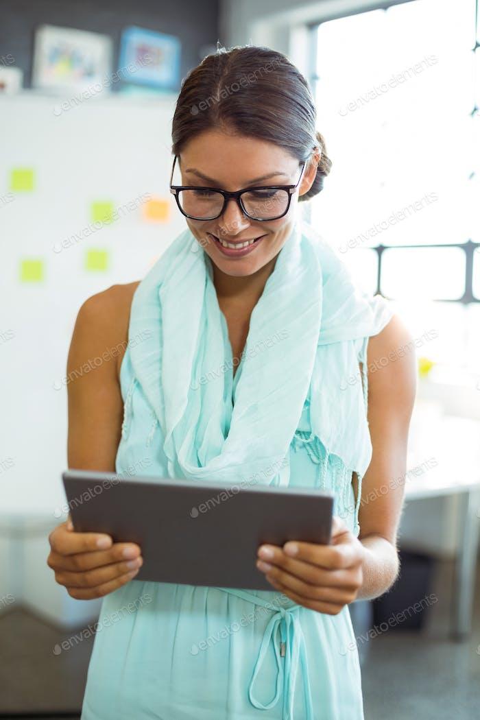 Business executive using digital tablet