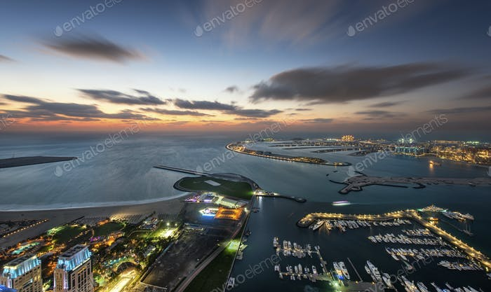 Aerial view of marina and Persian Gulf at dusk, Dubai, United Arab Emirates.