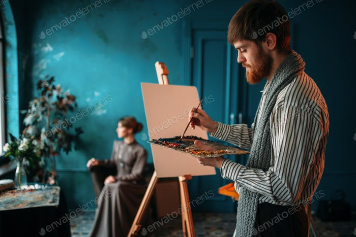 Male painter paints womans portrait
