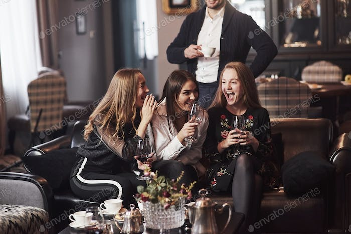 Laughing together. Family friends having nice time in beautiful luxury modern restaurant