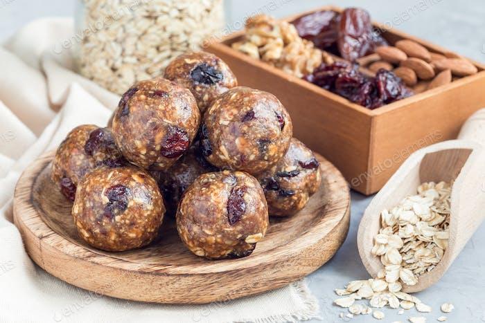Homemade energy balls on wooden plate, horizontal
