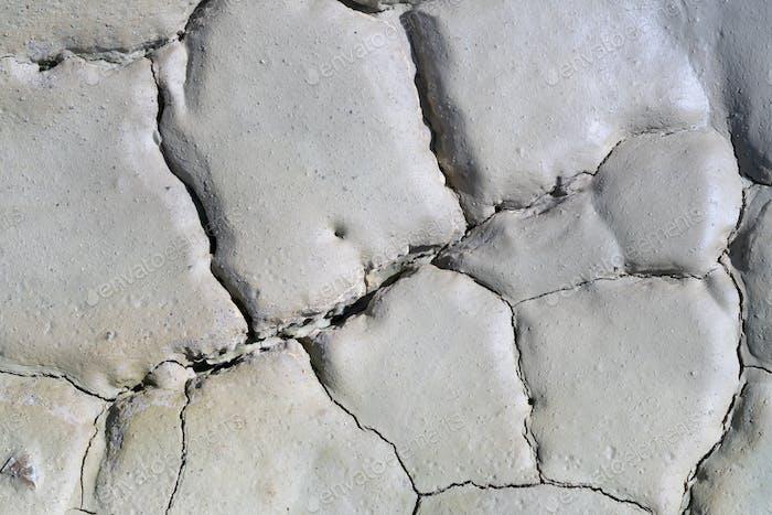 Light Gray Dry Cracked Surface of Volcanic Earth Turned Into Desert