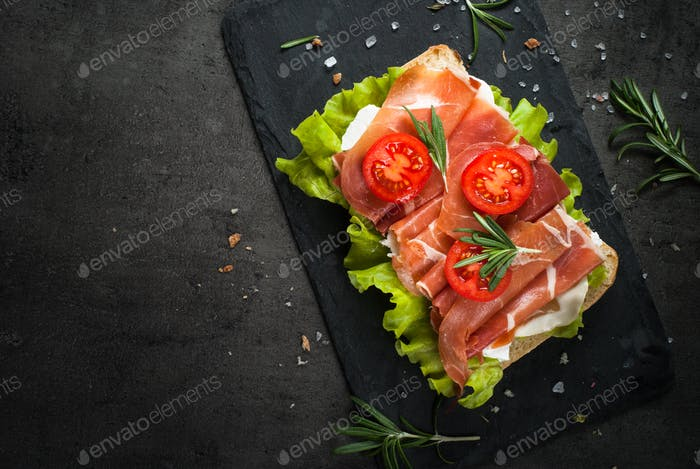 Ciabatta sandwich with  salad leaves jamon serrano mozzarella