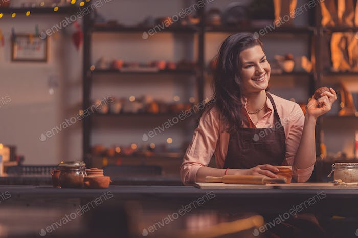 Attractive girl at work in pottery