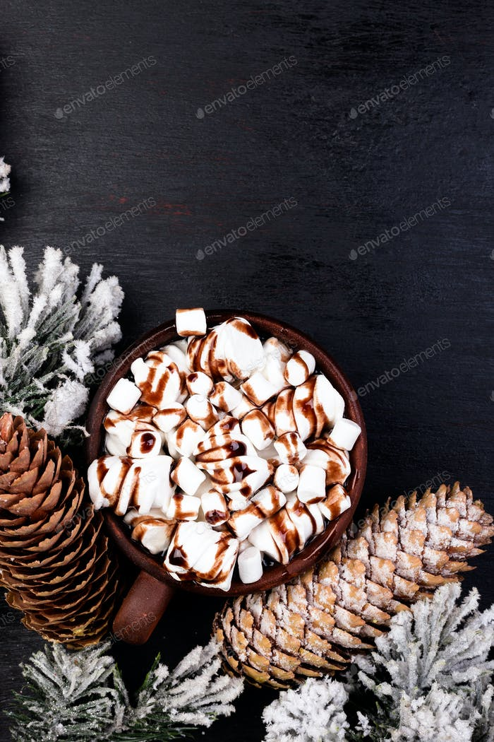 Christmas Food Sweet Marshmallow with Chocolate in Brown Cup on Black Background. Flat Lay