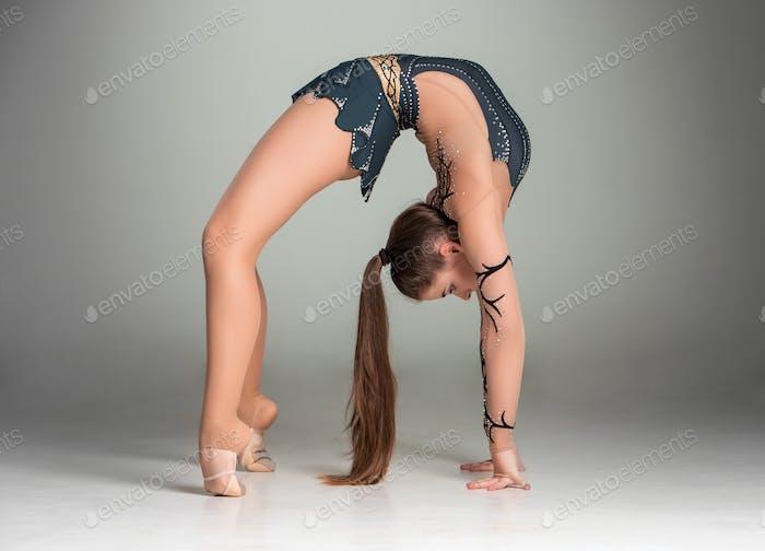 teenager doing gymnastics exercises