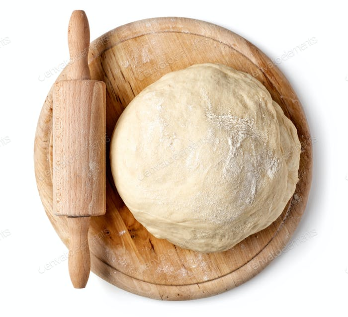 fresh raw dough on wooden board