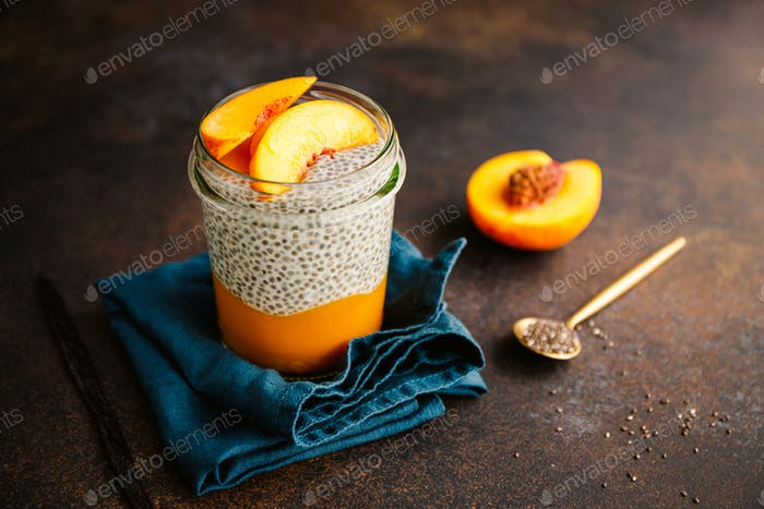 Portion healthy vegan chia pudding with almond milk, vanilla and peaches