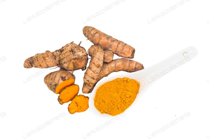 Turmeric roots and powder, healthy food with healing properties.