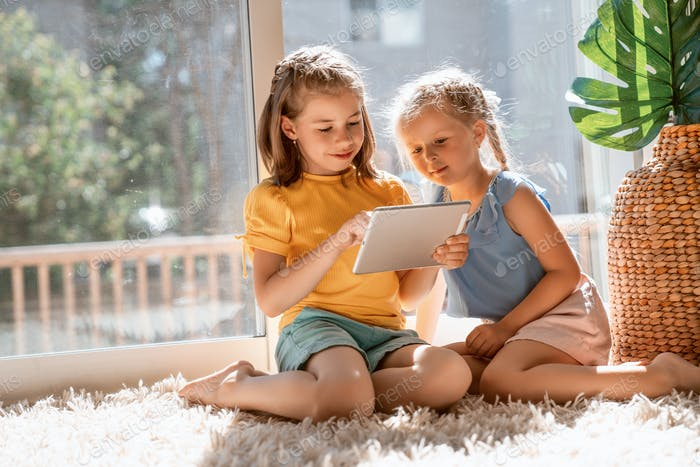 children are playing with tablet