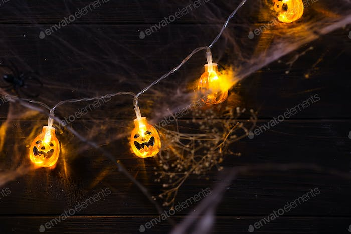 Halloween pumpkin orange Jack O'Lantern smiling face with as candle light lit on grunge