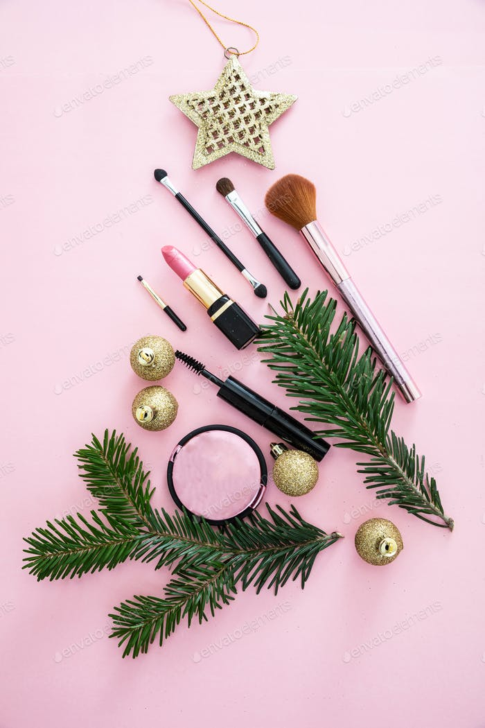 Make-up cosmetic christmas tree against pink background
