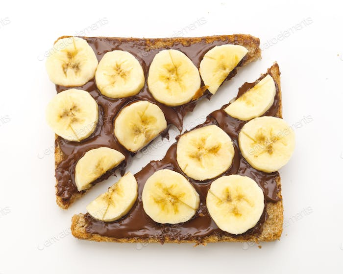 overhead shot of chocolate toast with cut banana, isolated on white