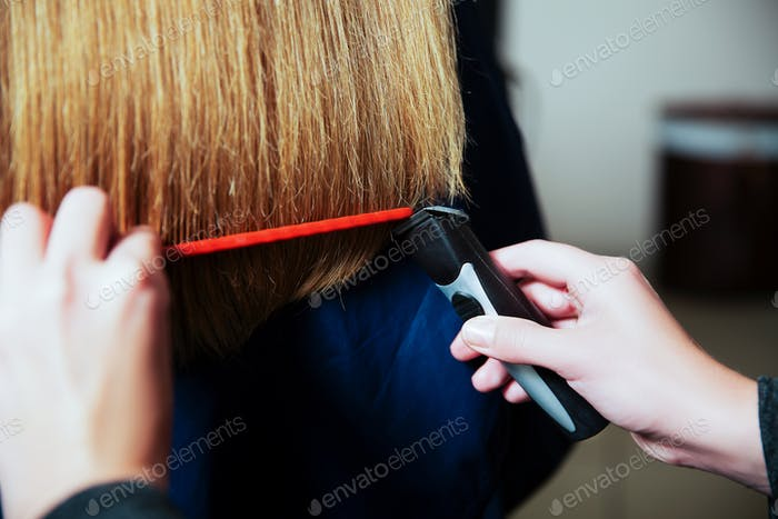 Hairdresser with machine for hair and hairbrush.