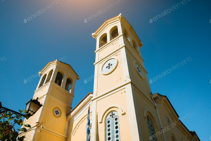 The bell towers of Greek Orthodox Church at sunlight, view from below