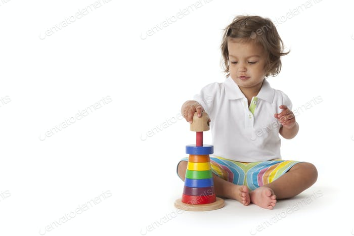 Toddler girl playing with colored bricks