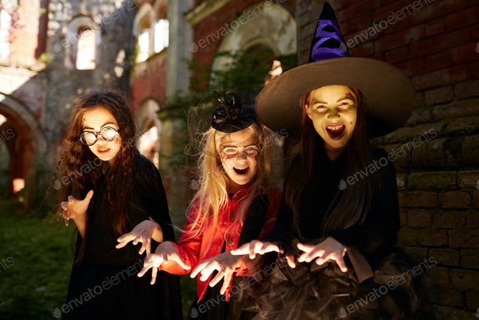 Girls Posing as Witches on Halloween