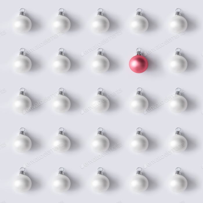 Christmas white decoration pattern with pink bauble. Minimal New Year flat lay background.