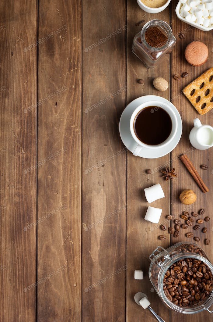 cup of coffee and beans on wooden background