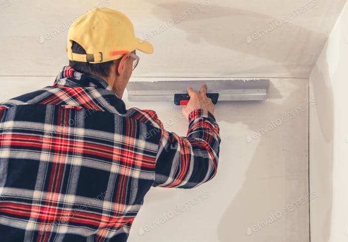 Construction Finishing Worker Patching Drywall