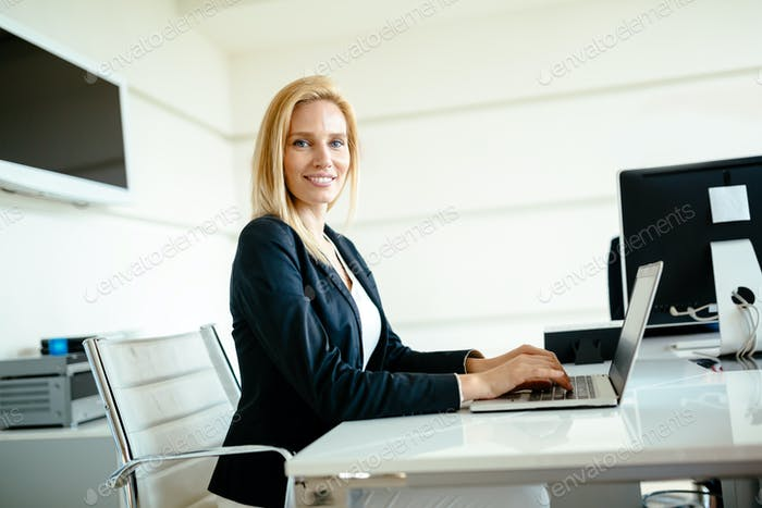 Beautiful businesswoman working in office