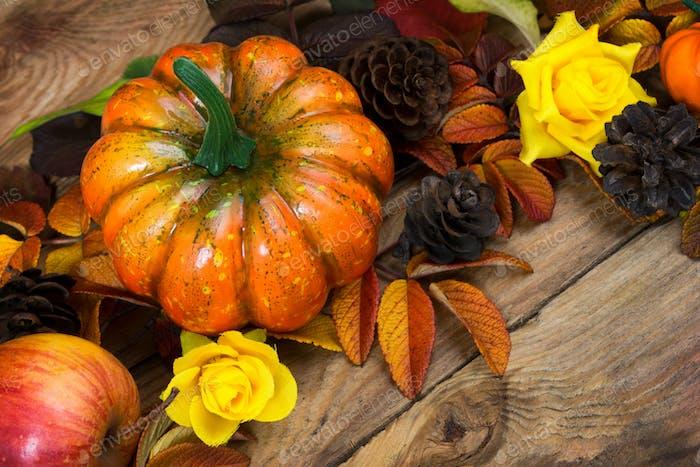 Fall pumpkin, cones, yellow roses arrangement