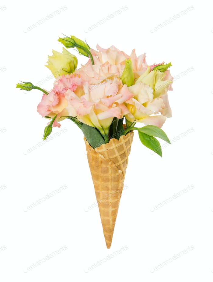 Waffle cone with flower bouquet isolated on white