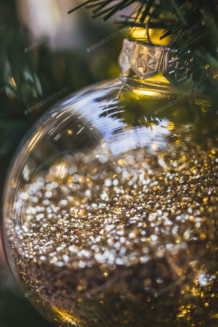 Christmas ball closeup with bright sparkles inside