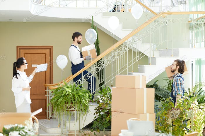 Stylish interior designer managing movers