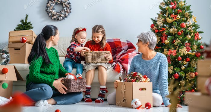 family preparing for Christmas