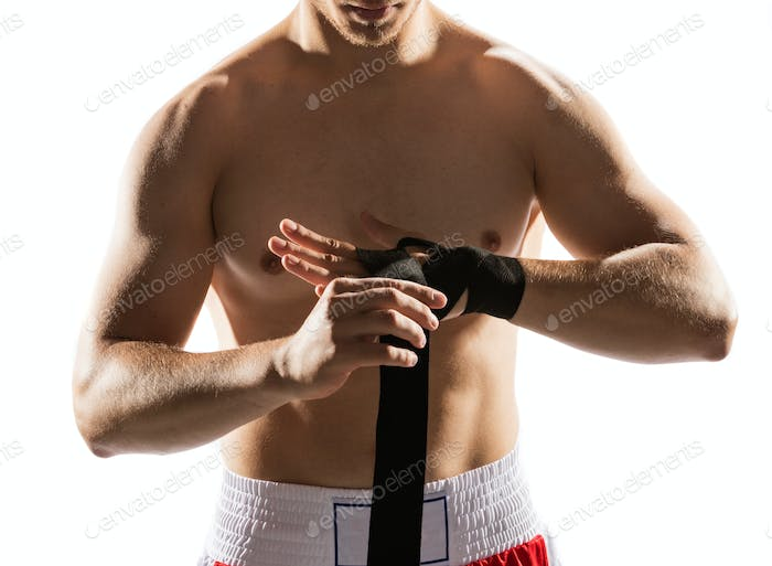 Boxer wrapping his hands with bandage