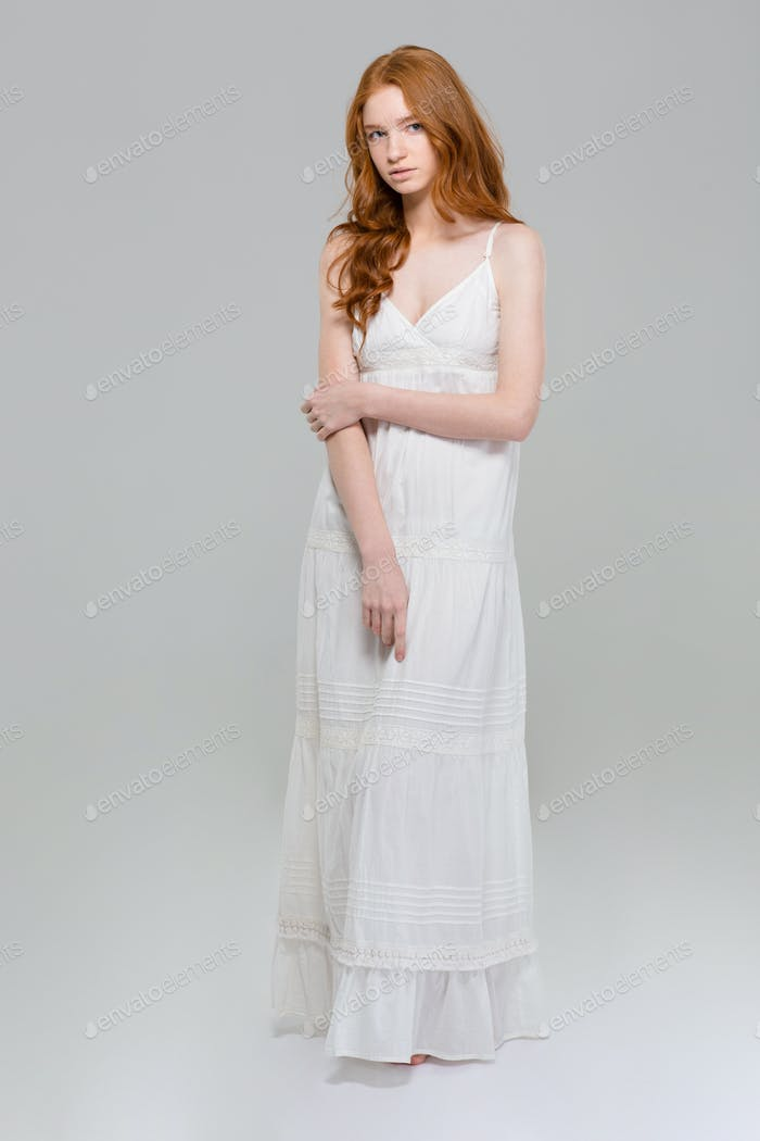 Full length portrait of a beautiful woman in dress