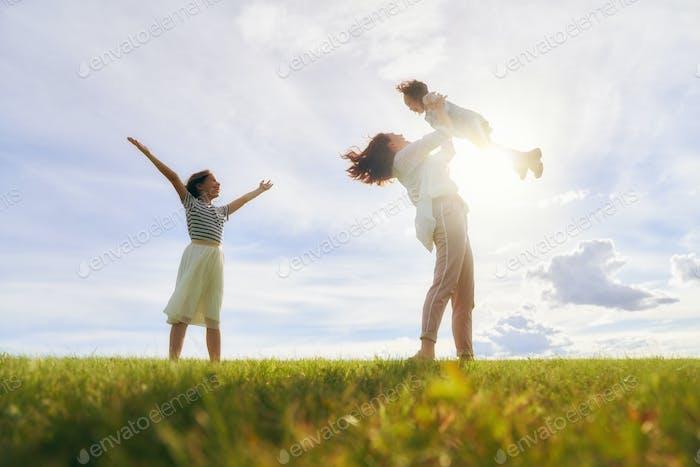 Happy family on summer walk