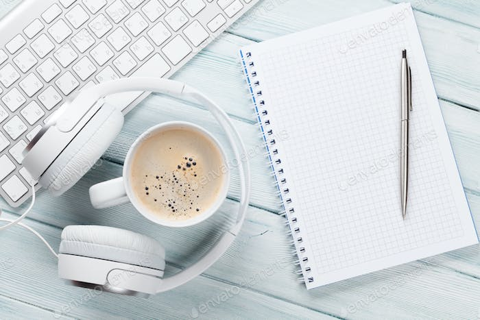 Headphones, coffee, notepad and pc