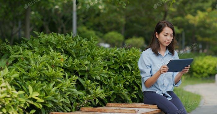 Woman look at tablet computer at outdoor