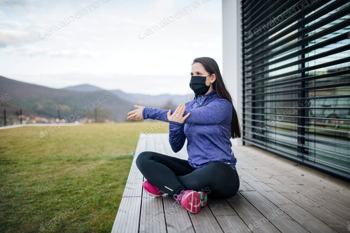Woman doing exercise outdoors at home, Corona virus and quarantine concept