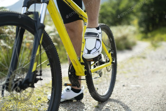 Closeup of a man wearing cycling shoes