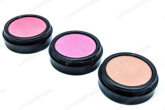 Three cosmetic of diferent colors